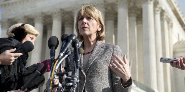 Massachusetts Attorney General Martha Coakley speaks to the media outside the US Supreme Court following oral arguments in th