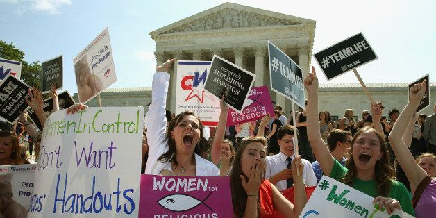 WASHINGTON, DC - JUNE 30: Hobby Lobby supporters react to the U.S. Supreme Court decision June 30, 2014 in Washington, DC. Th