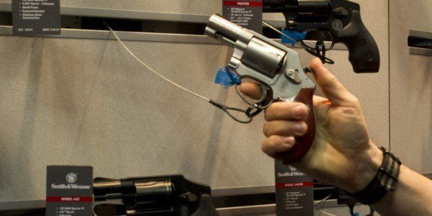 Convention goers look at the Smith & Wesson line of handguns at the 143rd NRA Annual Meetings and Exhibits at the Indiana Con