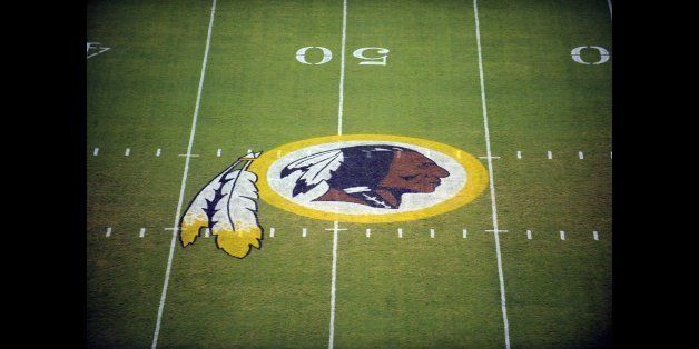 FILE - In this Aug. 28, 2009, file photo, the Washington Redskins logo is displayed at midfield before the start of a preseas