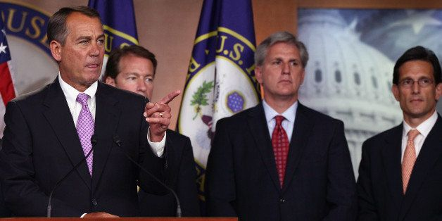 WASHINGTON, DC - JULY 14:  U.S. House Speaker John Boehner (R-OH) (L) answers questions during a press conference on a balanc