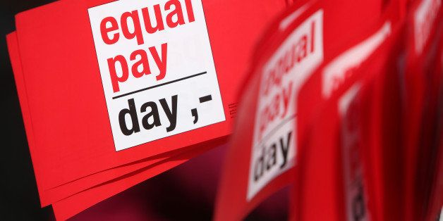 BERLIN, GERMANY - MARCH 21:  Flags reading 'Equal Pay Day' are seen during the 'Equal Pay Day' demonstration on March 21, 201