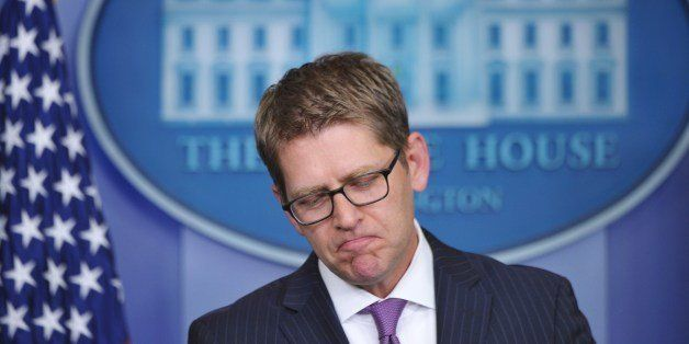 Outgoing White House Press Secretary Jay Carney pauses while speaking during his final press briefing in the Brady Briefing R