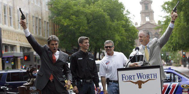 FORT WORTH, TX - APRIL 15:  Texas Governor Rick Perry, left, and Fort Worth mayor Mike Moncrief, right, fire six-shooter pist