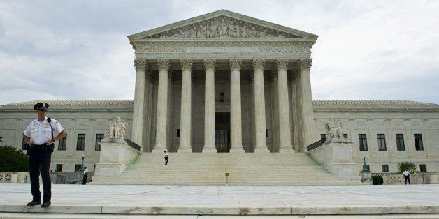 The US Supreme Court is seen in this June 19, 2014 photo in Washington, DC.  AFP PHOTO / Karen BLEIER        (Photo credit sh