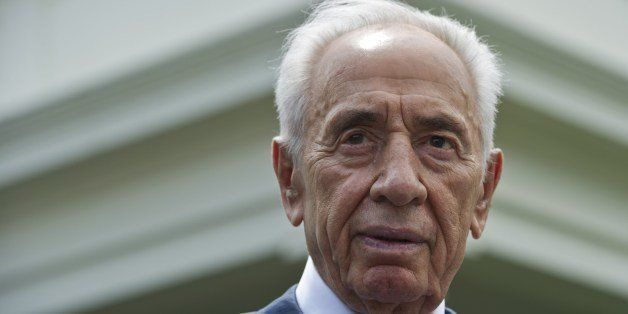 Israeli President Shimon Peres speaks to reporters outside of the West Wing after meeting with US President Barack Obama at t