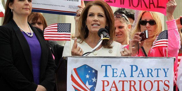WASHINGTON, DC - MARCH 28:  U.S. Rep. Michele Bachmann (R-MN) (2nd L) speaks as Tea Party Patriots national coordinator Jenny