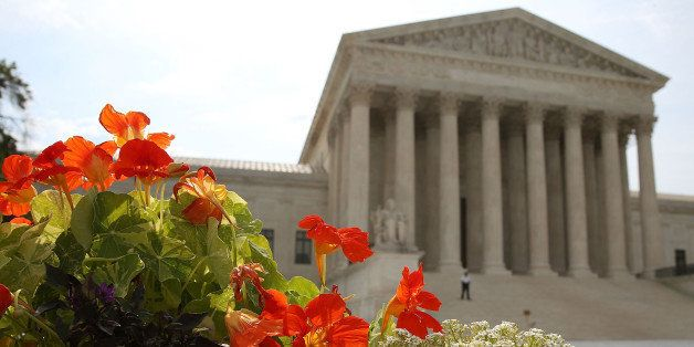 WASHINGTON, DC - JUNE 09: Flowers are bloom in front of the U.S. Supreme Court , on June 9, 2014 in Washington, DC. The high