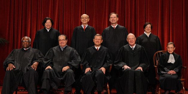WASHINGTON - OCTOBER 08:  U.S. Supreme Court members (first row L-R) Associate Justice Clarence Thomas, Associate Justice Ant