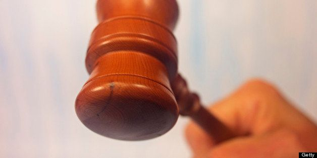 Justice or judgement a raised gavel about to strike. Sale at the end of an auction. Differential focus, limited depth of fiel