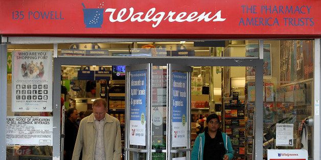 SAN FRANCISCO, CA - JUNE 19:  Customers walk out of a Walgreens store on June 19, 2012 in San Francisco, California.  U.S. ba