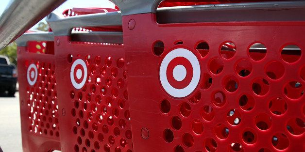 NOVATO, CA - MAY 22: Shopping carts sit in the parking lot of a Target store on May 22, 2013 in Novato, California. Target reported weaker than expected first quarter earnings with profits of $498 million, or 77 cents per share compared to $697 million, or $1.04 per share one year ago. (Photo by Justin Sullivan/Getty Images)