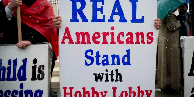 A demonstrator in favor of Hobby Lobby Stores Inc. and opposed to U.S. President Barack Obama's health-care law contraception