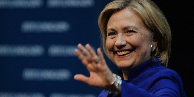Former US Secretary of State Hillary Clinton gestures during a presentation of her new book at Schiller theatre on July 6, 20