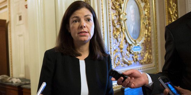US Senator Kelly Ayotte, R-NH, walks to the weekly policy luncheon on Capitol Hill in Washington, DC, October 15, 2013.  Wash