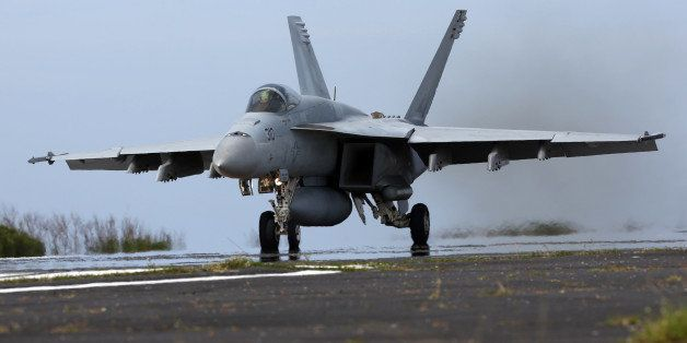 IWOJIMA, TOKYO, JAPAN - MAY 14: U.S. Navy F/A-18 Super Hornet take off during the Field Carrier Landing Practice of the Carrier Air Wing 5 of U.S. Naval Air Facility Atsugi on May 14, 2014 in Iwojima, Tokyo, Japan. The Iwo Jima Island is the setting of World War II Battle of Iwo Jima between the United States and Japan in 1945. Civilian access to the island is restricted to memorial attendees, workers for the naval air base, and meteorological agency officials. (Photo by Ken Ishii/Getty Images)