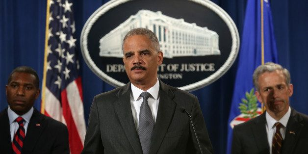 WASHINGTON, DC - JULY 14:  (L-R) U.S. Associate Attorney General Tony West (2nd L), U.S. Attorney General Eric Holder, and U.