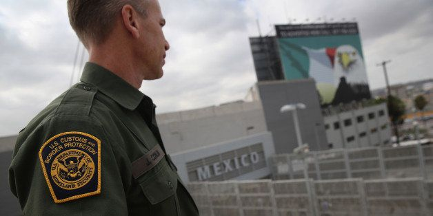 SAN YSIDRO, CA - OCTOBER 03:  U.S. Border Patrol agent Jerry Conlin stands on the American side of the U.S.-Mexico border on