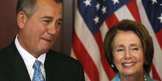 WASHINGTON, DC - JULY 11:  House Minority Leader Nancy Pelosi (D-CA) (R) and House Speaker John Boehner (R-OH) await to sign