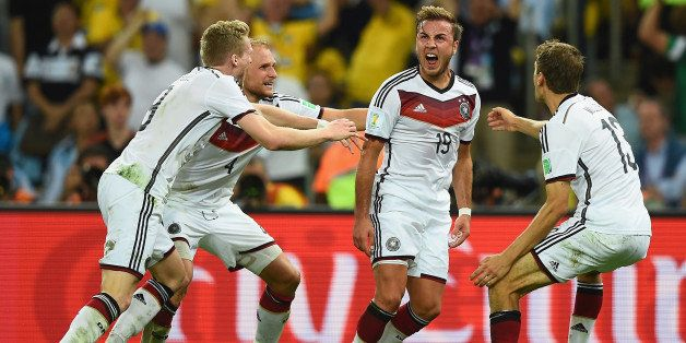 RIO DE JANEIRO, BRAZIL - JULY 13:  Mario Goetze of Germany (2nd R) celebrates scoring his team's first goal in extra time wit
