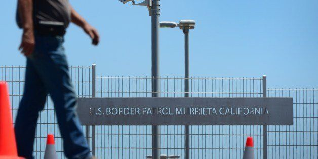 Anti-illegal immigration resident Burke (no last name given) patrols outside the US Border Patrol facility in Murrieta, Calif
