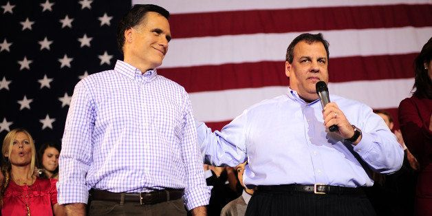 Republican presidential hopeful Mitt Romney receives the endorsement of New Jersey Governor Chris Christie (R) during a rally