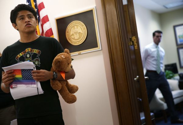 Oliver Merino of Charlotte, North Carolina, protests outside the office of Sen. Roger Wicker (R-Miss.).