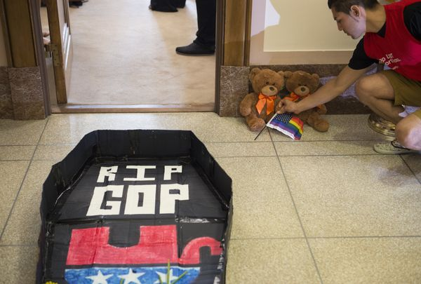 Protestors with the group United We Dream leave teddy bears outside a congressional office.