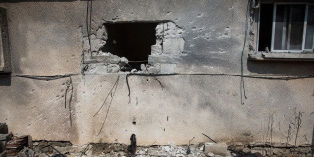 SDEROT, ISRAEL - JULY 21:  A hole, allegedly caused by a Hamas rocket, is seen in an Israeli home on July 21, 2014 in Sderot,