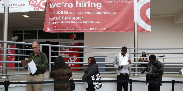SAN FRANCISCO, CA - AUGUST 15:  Job seekers wait in line to enter a job fair at a new Target retail store on August 15, 2013