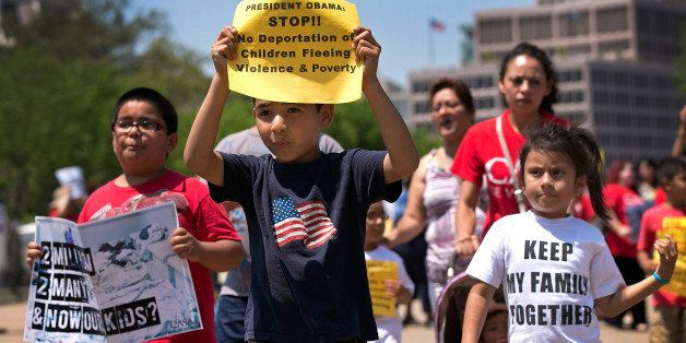 WASHINGTON, DC - JULY 07:  Young children join immigration reform protesters while marching in front of the White House July