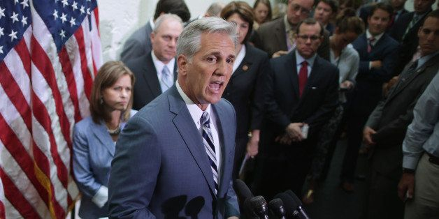 WASHINGTON, DC - JULY 09:  House majority leader-elect Rep. Kevin McCarthy (R-CA) (C) talks with reporters after the weekly H