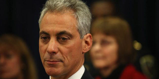 CHICAGO, IL - DECEMBER 20: Chicago Mayor Rahm Emanuel listens to speakers during a press conference with a group of Chicago a