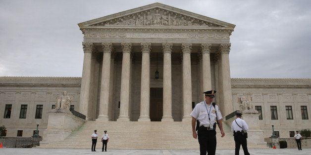 WASHINGTON, DC - JUNE 30: Police stand in front of the U.S. Supreme Court on June 30, 2014 in Washington, DC. Today the high