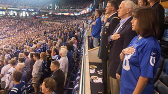 Vice President Mike Pence and Second Lady Karen Pence stand during the national anthem prior to the start of an NFL football game between the Indiana Colts and the San Francisco 49ers at the Lucas Oil Stadium in Indianapolis, Indiana, U.S., October 8, 2017.    White House/Myles Cullen/Handout via REUTERS   ATTENTION EDITORS - THIS IMAGE WAS PROVIDED BY A THIRD PARTY.