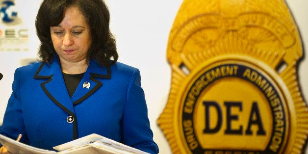 US Deputy administrator of the US Drug Enforcement Administration, Michele Leonhart, holds folders with documents during the