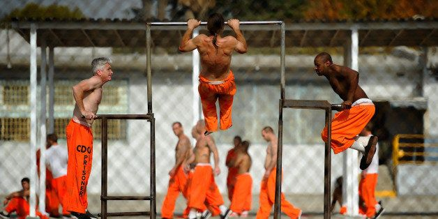 CHINO, CA - DECEMBER 10:  Inmates at Chino State Prison exercise in the yard December 10, 2010 in Chino, California. The U.S.