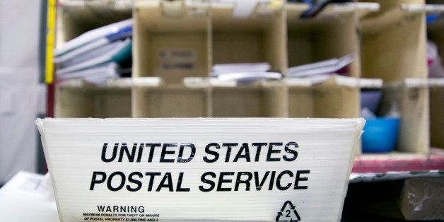 A U.S. Postal Service (USPS) tray sits at the Brookland Post Office in Washington, D.C., U.S., on Thursday, May 9, 2013. The