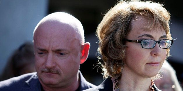 TUCSON, AZ - MARCH 06: Former U.S. Rep. Gabby Giffords and her husband Mark Kelly attend a news conference outside Safeway gr