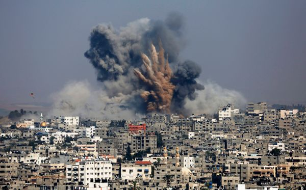 Smoke and fire from the explosion of an Israeli strike rise over Gaza City, Tuesday, July 29, 2014. Israel escalated its mili