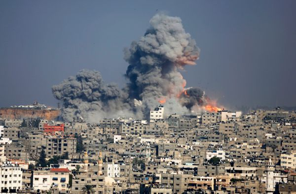 Smoke and fire from the explosion of an Israeli strike rise over Gaza City,  Tuesday, July 29, 2014. Israel escalated its mil