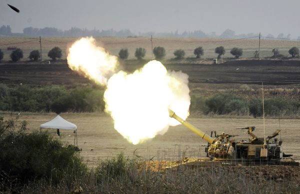 An Israeli canon fires a 155mm shell towards targets in the Gaza Strip from their position along the border between Israel an