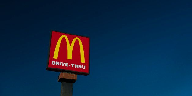 McDonald's Corp. signage stands outside of a restaurant in San Pablo, California, U.S., on Wednesday, Jan. 22, 2014. McDonald