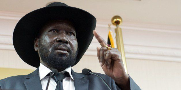 South Sudan President Salva Kiir holds a press conference in a room full of ministers and journalists, urging peace and recon