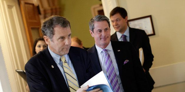 WASHINGTON, DC - APRIL 24:  Sen. Sherrod Brown (D-OH) (L) and Sen. David Vitter (R-LA) (R) arrive for a press conference anno