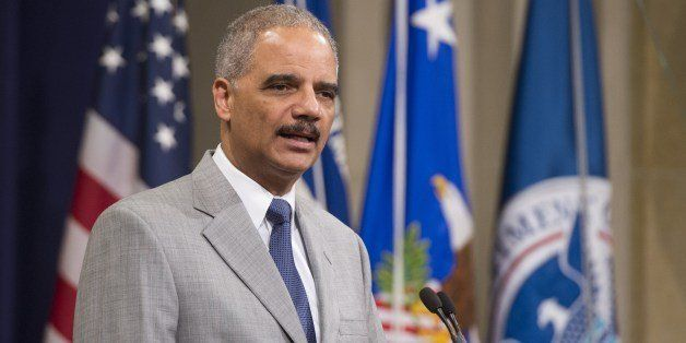 US Attorney General Eric Holder speaks during a Naturalization Ceremony at the Justice Department in Washington, DC, July 22,