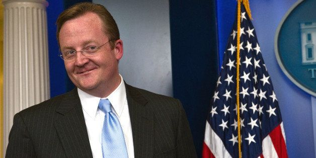 Outgoing US Press Secretary Robert Gibbs speaks with reporters after his final briefing to the press in the White House brief