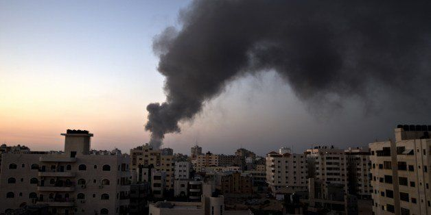 Smoke raises over Gaza City after an Israeli airstrike in Gaza city on August 10, 2014. Israel and the Palestinians agreed to