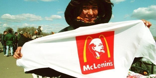 A vendor displays a Lenin/McDonald's T-shirt for sale in Moscow, on April 22, 1994. Today is the 124th anniversary of Vladimi
