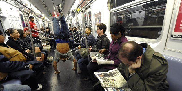 New York City Subway dancer Marcus Walden aka 'Mr Wiggles' performs acrobatic tricks on the subway while passengers watch Nov